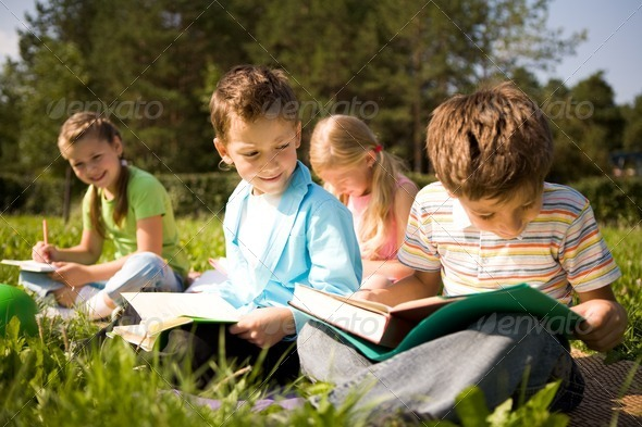 Reading outdoors - Stock Photo - Images