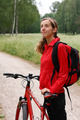 Woman cyclist on a bicycle walk on the park