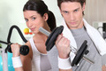 Young woman and young man healthy with barbells