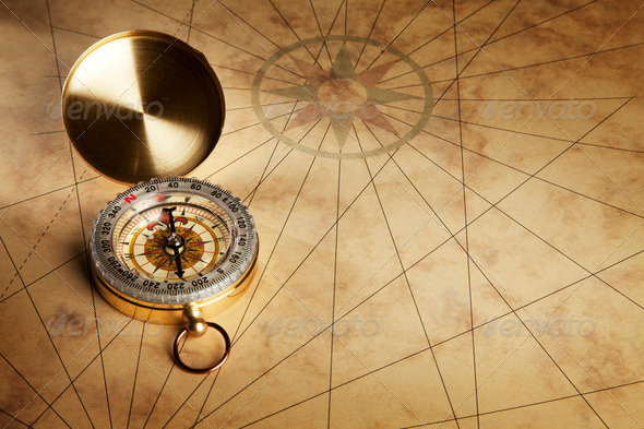 Compass on the old paper background - Stock Photo - Images