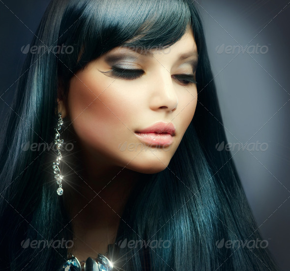 Beautiful Brunette Girl. Healthy Long Hair and Holiday Makeup - Stock Photo - Images
