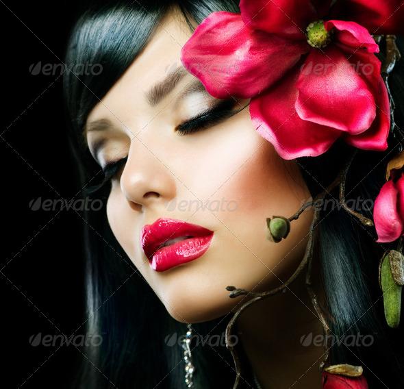 PhotoDune Fashion Brunette Girl with Magnolia Flower isolated on Black 2488106