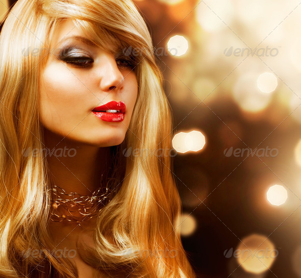 Blond Fashion Girl. Blonde Hair. Golden background - Stock Photo - Images