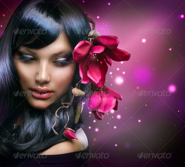 Fashion Brunette Girl with Magnolia Flowers - Stock Photo - Images