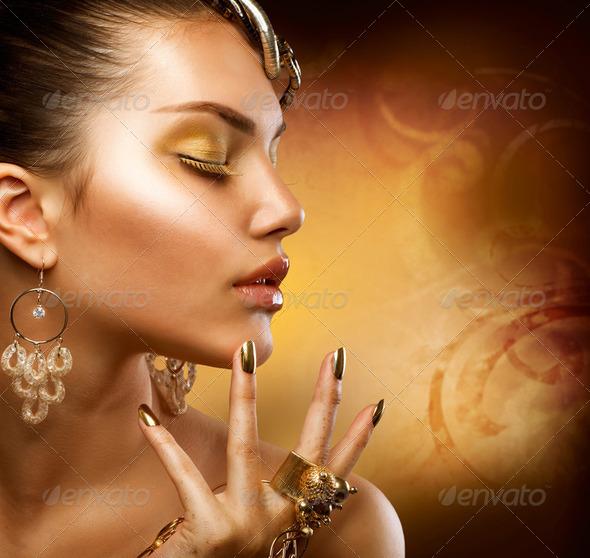 Gold Makeup. Fashion Girl Portrait - Stock Photo - Images