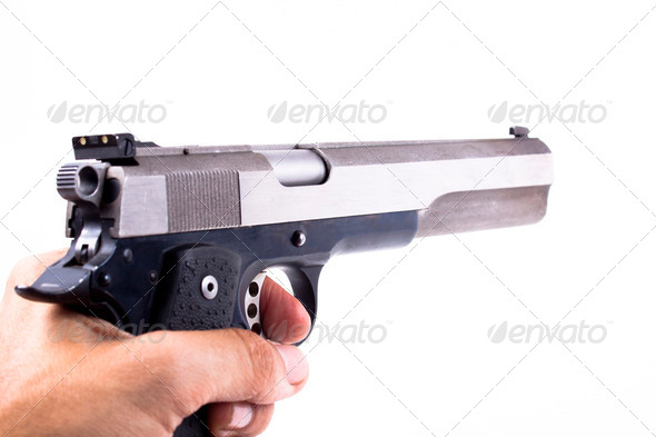 Holding a Gun - Stock Photo - Images
