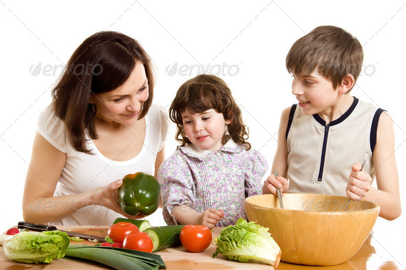 mother and children cooking at the kitchen - Stock Photo - Images