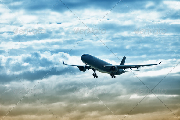 Airliner landing on evening sky - Stock Photo - Images