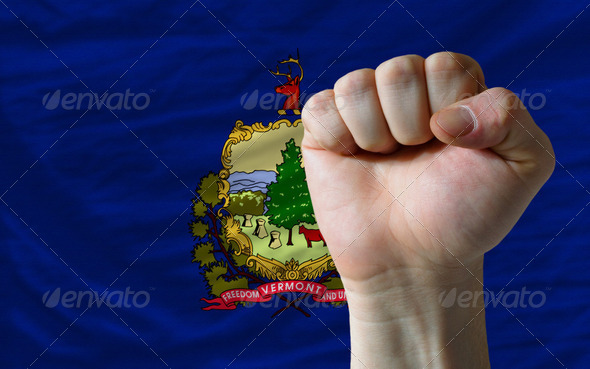 us state flag of vermont with hard fist in front of it symbolizi - Stock Photo - Images