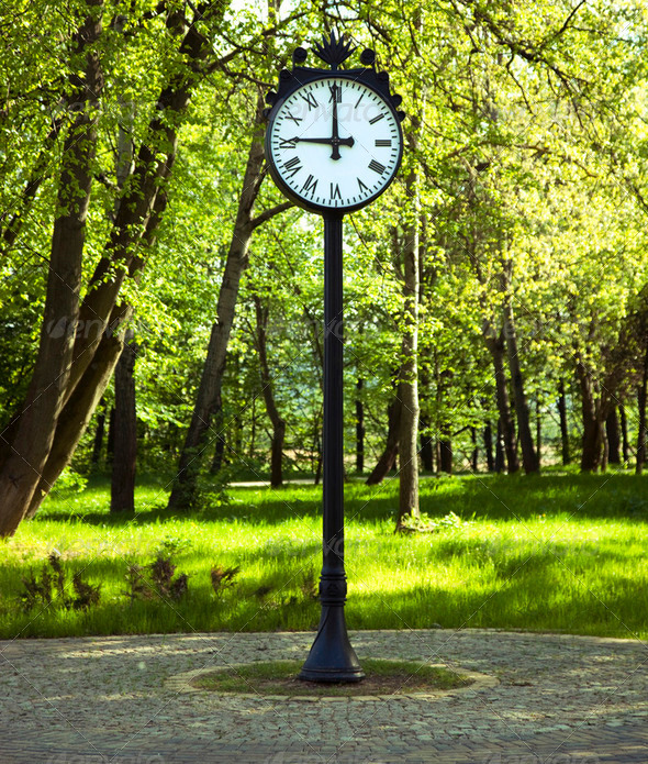 Clock in green park - Stock Photo - Images