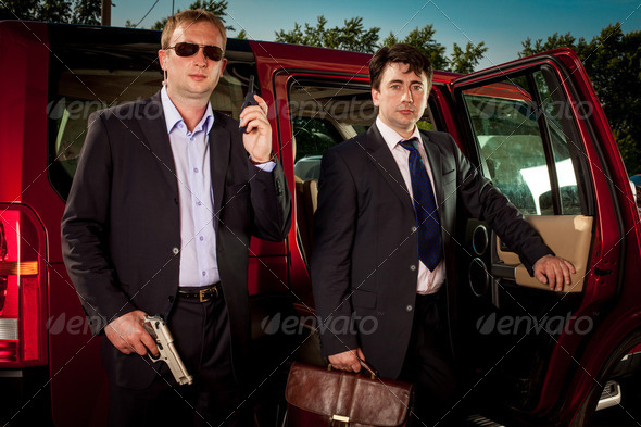 bodyguard and its boss - Stock Photo - Images