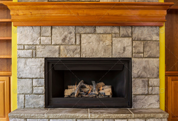 Natural Gas Insert Fireplace with Stone and Wood - Stock Photo - Images