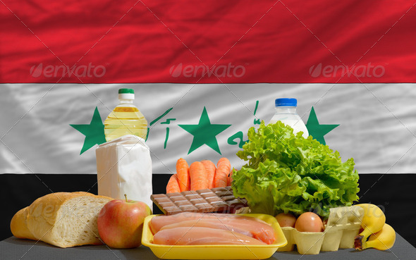 basic food groceries in front of iraq national flag - Stock Photo - Images
