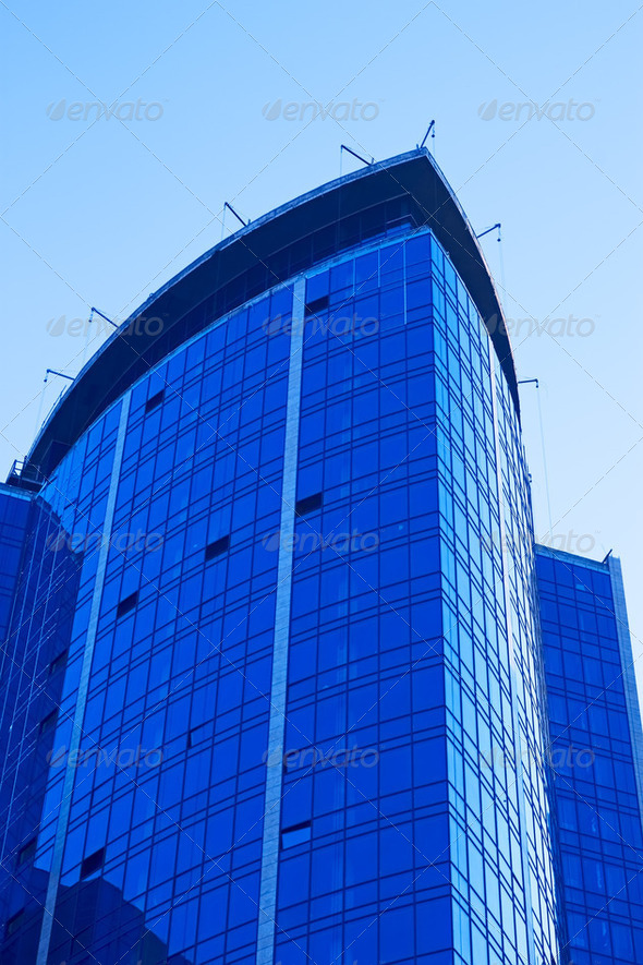 Skyscraper against a cloudless sky - Stock Photo - Images