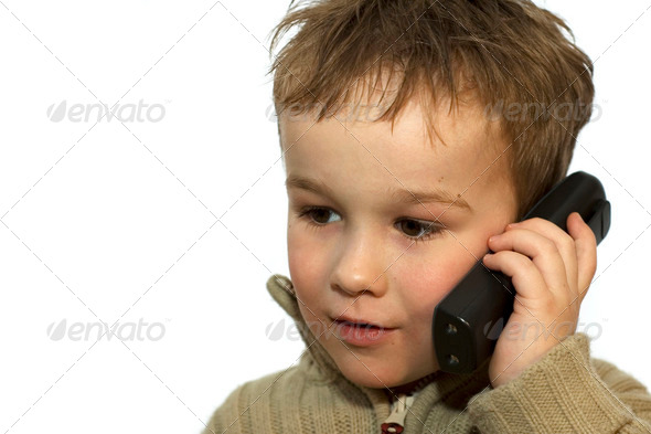 Young Boy On Phone 1 - Stock Photo - Images