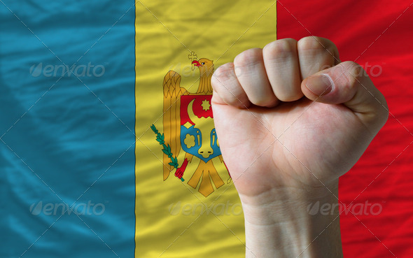 Hard fist in front of moldova flag symbolizing power - Stock Photo - Images