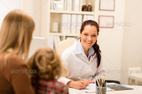 Mother and child girl visit pediatrician office - Stock Photo - Images