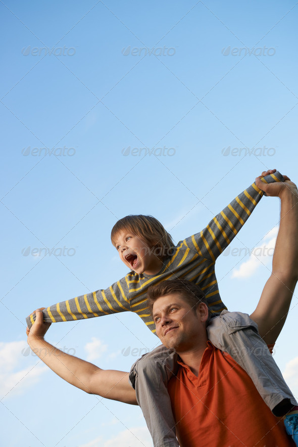 Happy son on the shoulders of the father - Stock Photo - Images