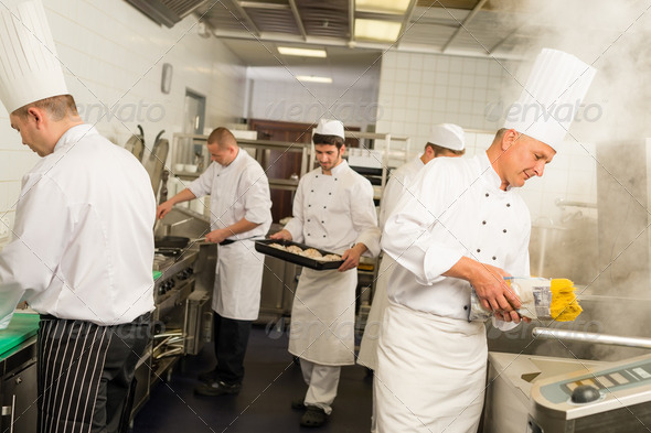 Professional kitchen busy team cooks and chef - Stock Photo - Images