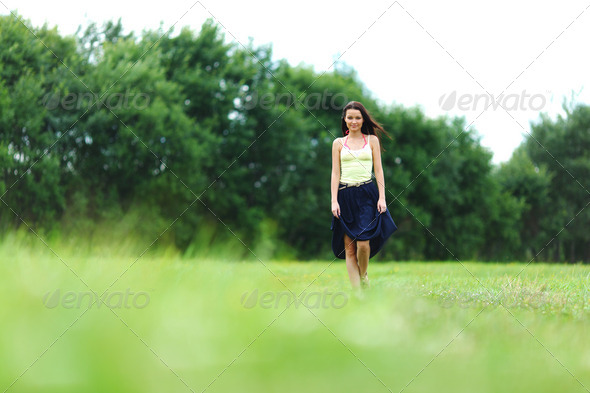 woman on green grass field - Stock Photo - Images