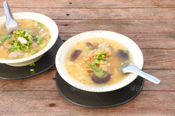 Pork and mushroom congee on morning table. - Stock Photo - Images