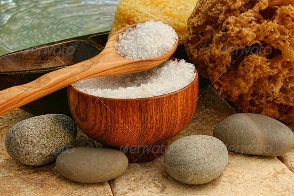 Bath salts with river rocks and sponges - Stock Photo - Images