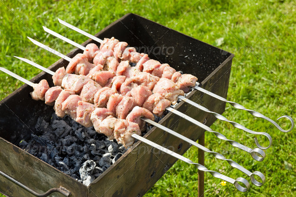 Meat Pieces Cooking On A Skewer - Stock Photo - Images