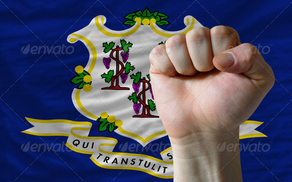 us state flag of connecticut with hard fist in front of it symbo - Stock Photo - Images