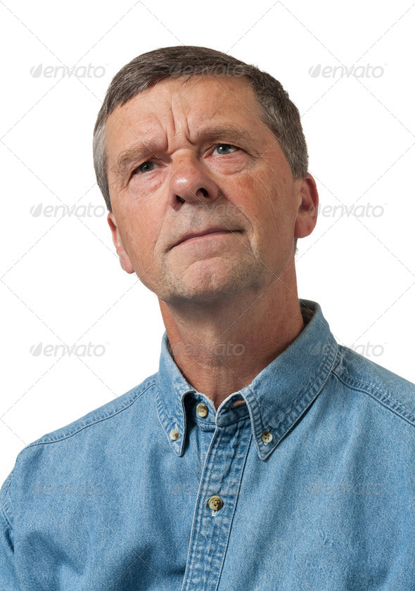Senior man in blue shirt looks pensive - Stock Photo - Images