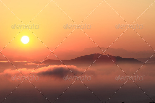 Scenic view of beautiful sunset over the mountains - Stock Photo - Images
