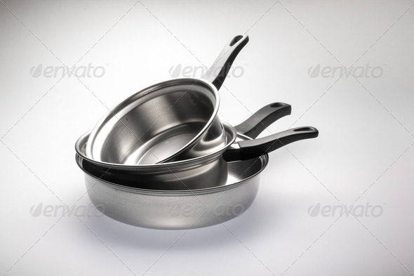 Clean and shiny stainless steel pots and pans. - Stock Photo - Images