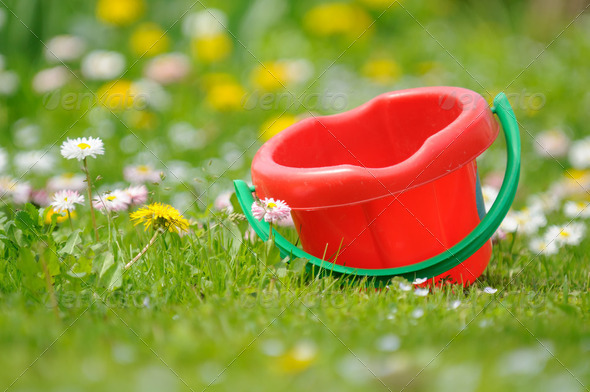 Kids' Sand Bucket in the Garden - Stock Photo - Images