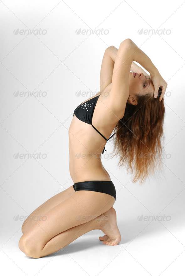 Woman in swimsuit, side view - Stock Photo - Images