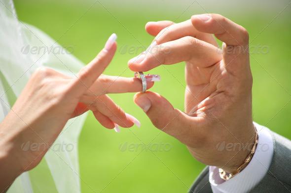 Exchange of wedding rings - Stock Photo - Images