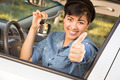 Happy Smiling Mixed Race Woman in Car with Thumbs Up Holding Set of Keys. - PhotoDune Item for Sale