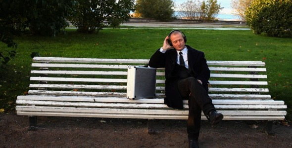 Senior Businessman Enjoying Music Outside