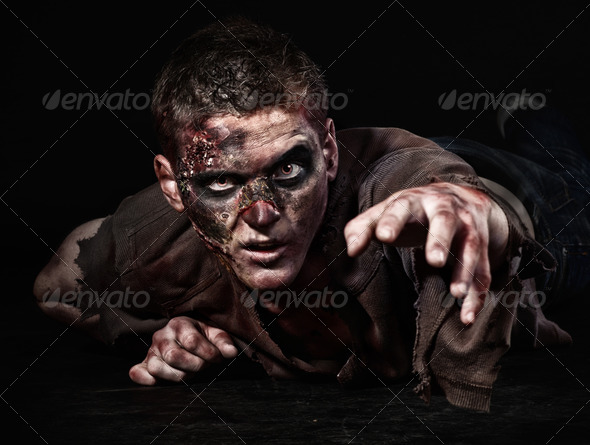 The zombie is lying in the studio - Stock Photo - Images