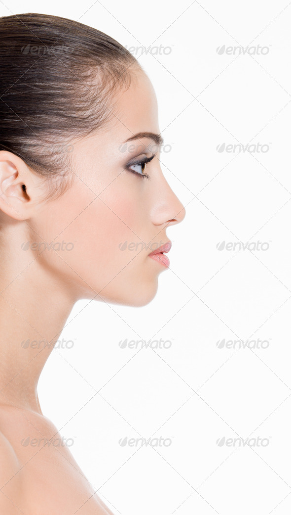Profile face of a young woman - Stock Photo - Images