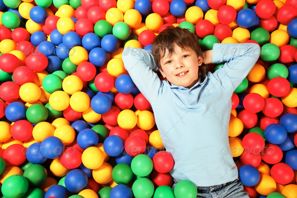 Boy on balls - Stock Photo - Images