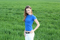 Young Smiling Woman Standing On The Green Grass - PhotoDune Item for Sale