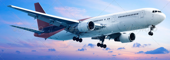 Aircraft is maneuvering in a sunset sky - Stock Photo - Images