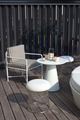 Table and chairs in a home exterior patio with wooden decking - PhotoDune Item for Sale