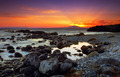 Glorious sunset over rocky sea - PhotoDune Item for Sale