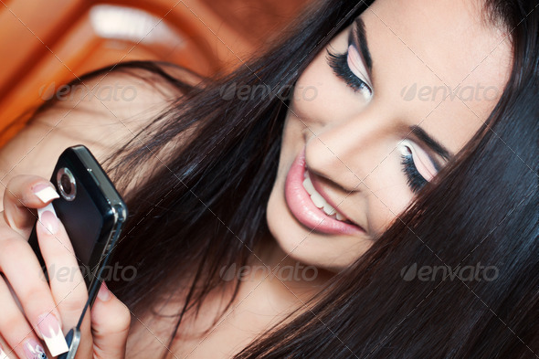 girl talking on the phone - Stock Photo - Images