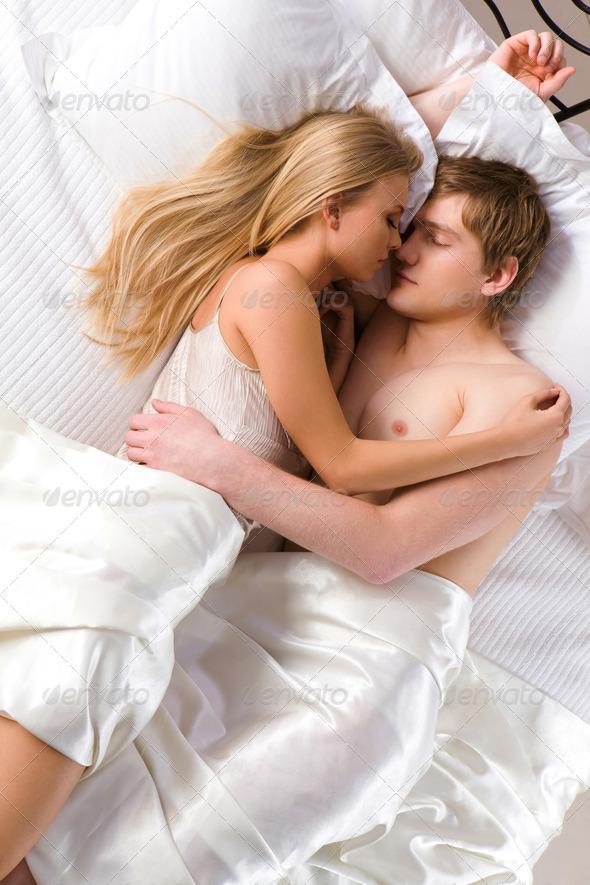 husband and wife sleeping nude