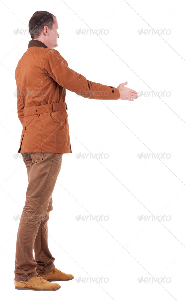 back view of businessman in  movement reaches out to shake hands - Stock Photo - Images