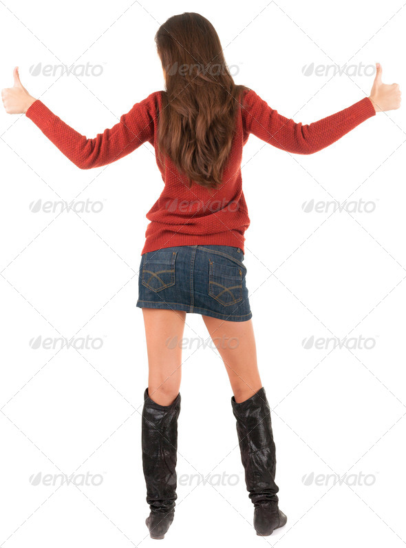 Back view of of young brunette woman in jeans and sweater going - Stock Photo - Images