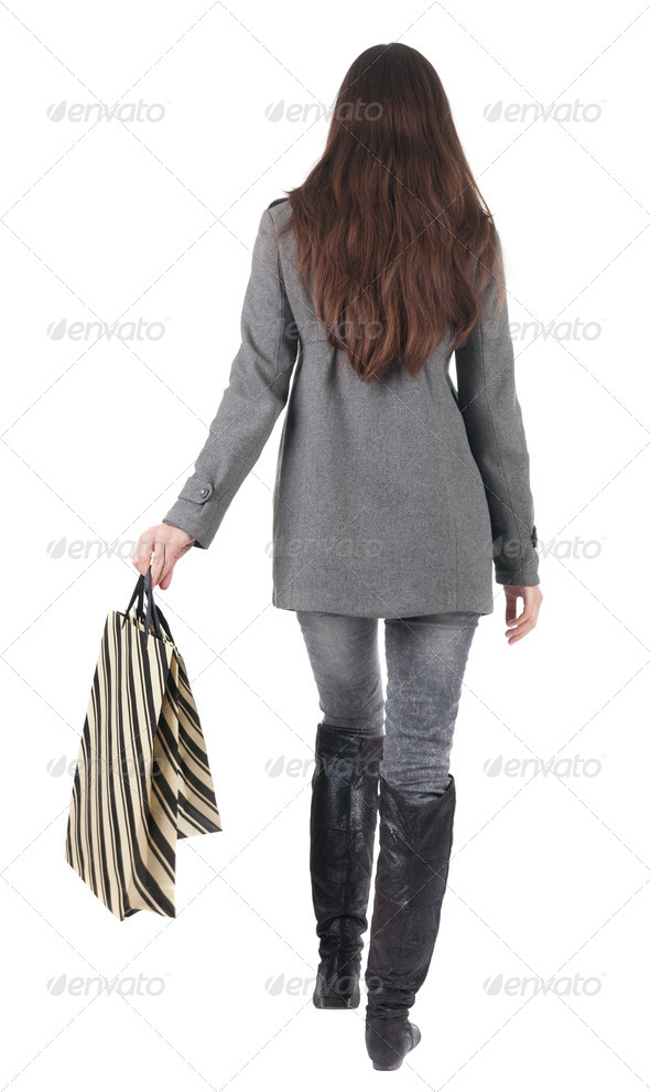 back view of going  woman with shopping bags - Stock Photo - Images