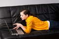 girl on sofa with laptop, she watches the display - PhotoDune Item for Sale