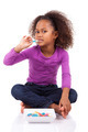 Little African Asian girl eating  candy - PhotoDune Item for Sale